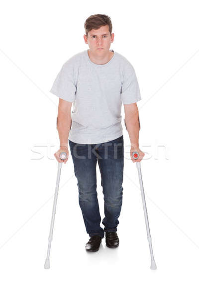 Young Man Walking With Two Crutches Stock photo © AndreyPopov