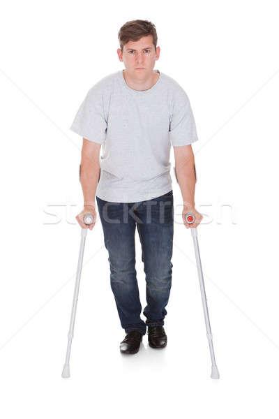 若い男 徒歩 2 松葉杖 小さな ハンサムな男 ストックフォト © AndreyPopov