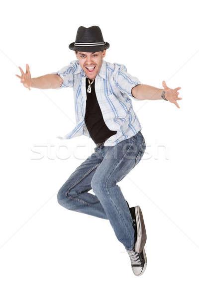 Młodych tancerz powietrza skok broni człowiek Zdjęcia stock © AndreyPopov