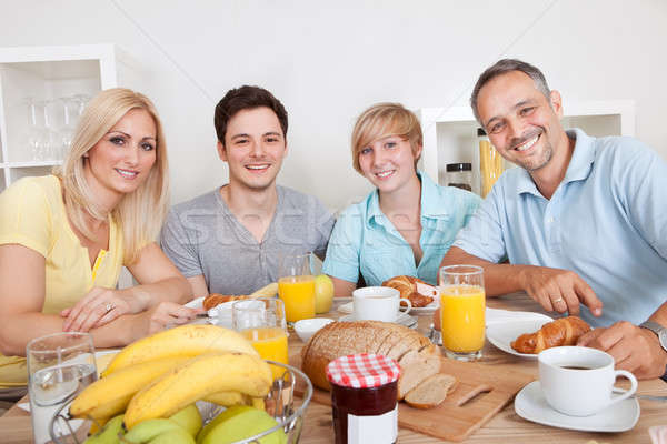 Happy family enjoying breakfast Stock photo © AndreyPopov