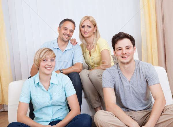 Smiling family in group portrait Stock photo © AndreyPopov
