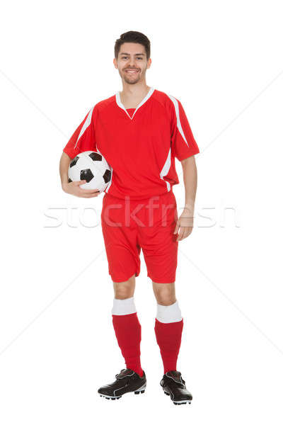 Young Soccer Player Holding Ball Stock photo © AndreyPopov