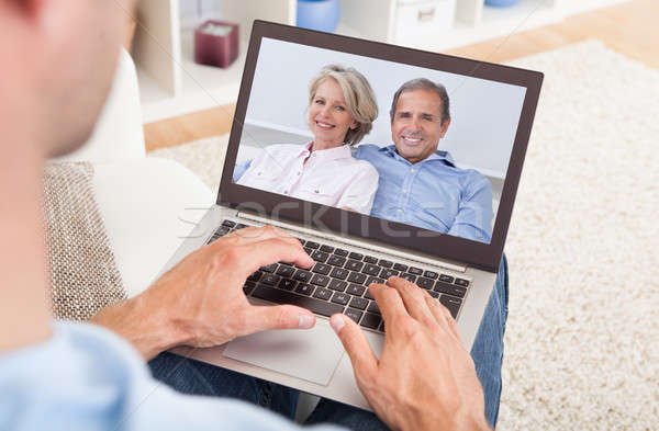 Man Having A Video Chat With Parents Stock photo © AndreyPopov