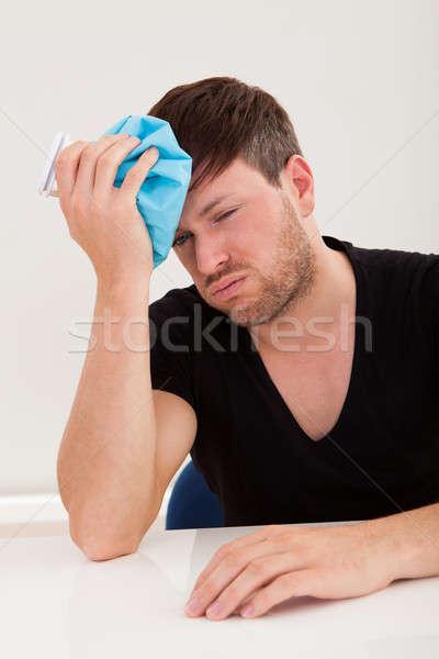 Sober guy got headache Stock photo © AndreyPopov