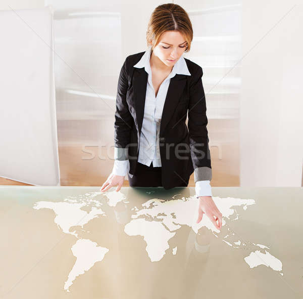 Woman Pointing On Transparent Screen Stock photo © AndreyPopov