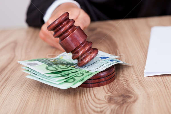 Male Judge Striking The Gavel On Euro Note Stock photo © AndreyPopov