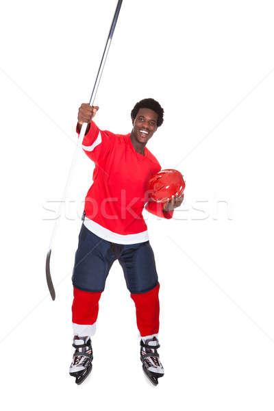 Jégkorong játékos élvezi siker portré fehér Stock fotó © AndreyPopov