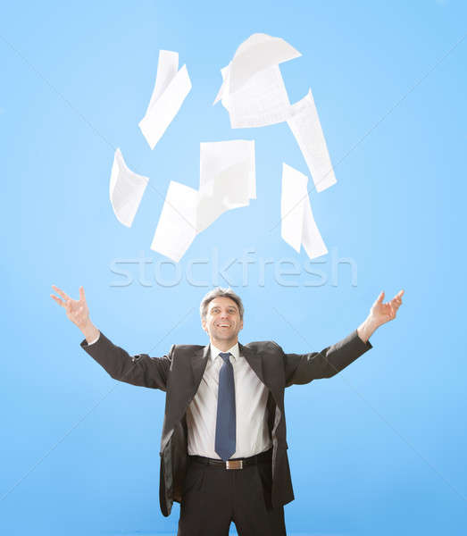 Senior businessman throwing sheets of paper Stock photo © AndreyPopov