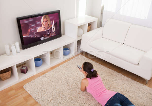 Young Woman Watching Television Stock photo © AndreyPopov