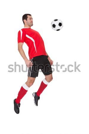Professional soccer player kicking ball Stock photo © AndreyPopov