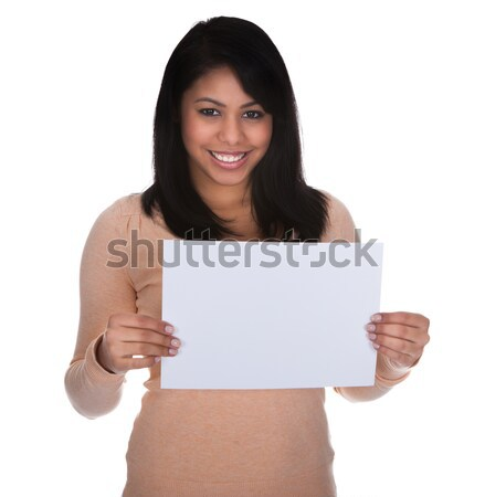 Young Woman Pointing At Placard Stock photo © AndreyPopov