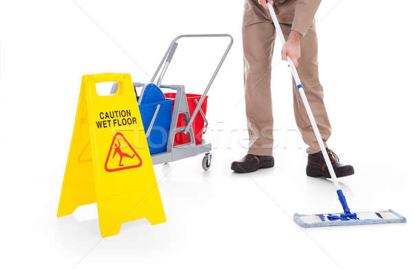 Sweeper Cleaning Floor With Warning Sign Stock photo © AndreyPopov