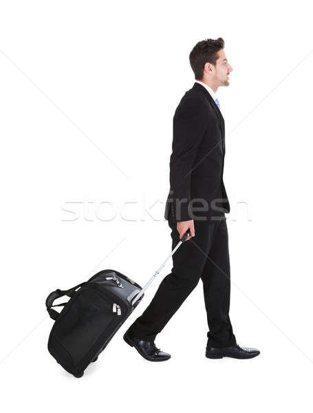 ビジネスマン 荷物 徒歩 白 側面図 ストックフォト © AndreyPopov