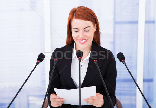 Smiling Businesswoman Giving Speech At Conference Stock photo © AndreyPopov