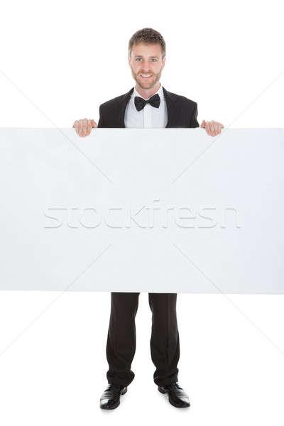 Komornyik néz óriásplakát fiatal izolált fehér Stock fotó © AndreyPopov