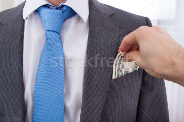 Hand Bribing Businessman Stock photo © AndreyPopov