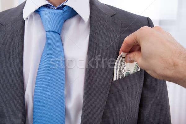 手 ビジネスマン お金 ポケット ビジネス 紙 ストックフォト © AndreyPopov