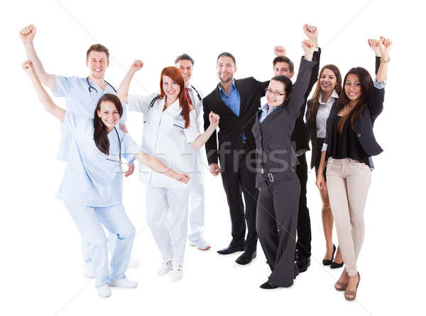 Doctors and managers raising arms Stock photo © AndreyPopov