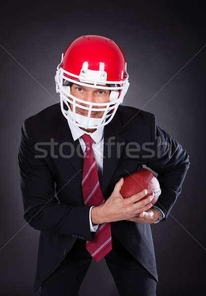 Businessman Holding Rugby Ball Stock photo © AndreyPopov