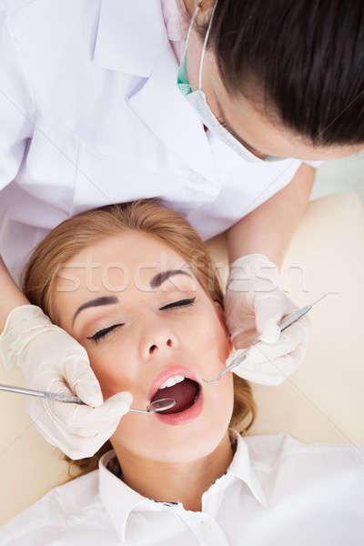 Young Woman Having Dental Checkup Stock photo © AndreyPopov