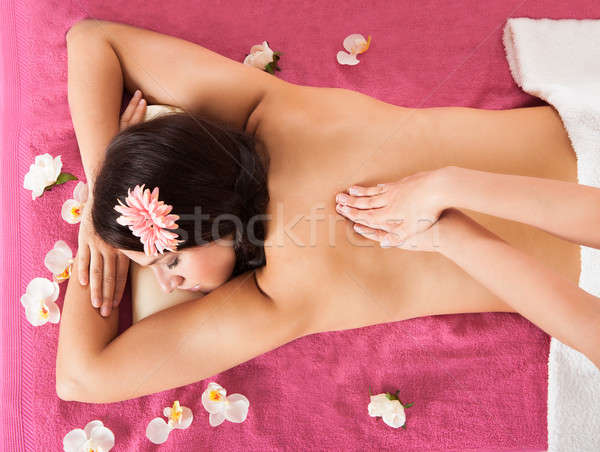 Woman Receiving Back Massage At Beauty Spa Stock photo © AndreyPopov