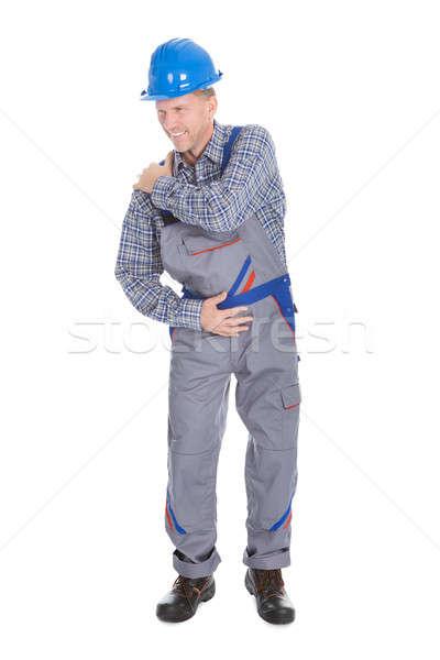 Mężczyzna pracownika cierpienie ból barku odizolowany biały Zdjęcia stock © AndreyPopov