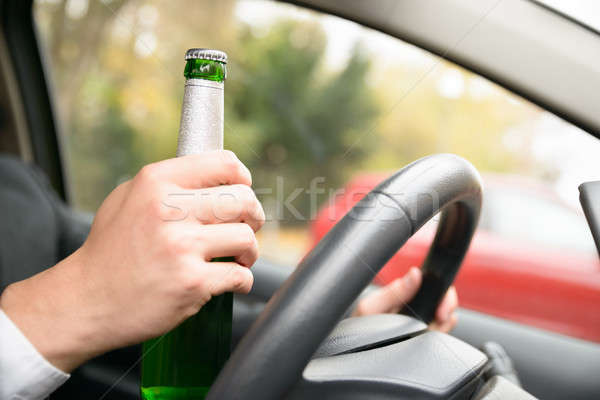 Person Holding Beer Bottle In Car Stock photo © AndreyPopov