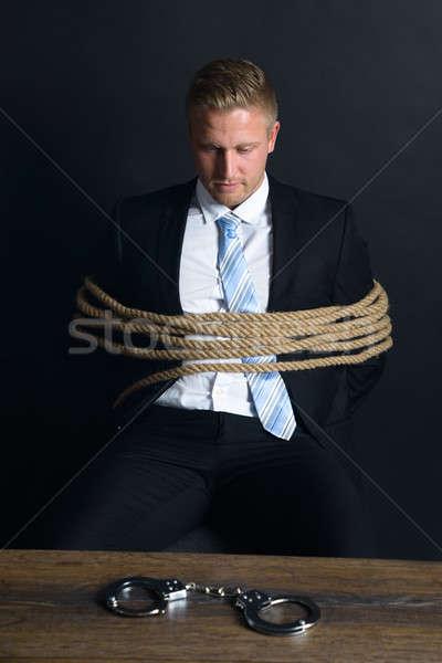 Empresario cuerda sesión mesa retrato jóvenes Foto stock © AndreyPopov