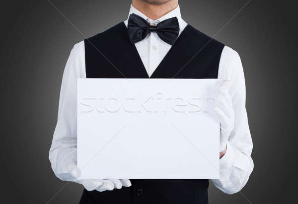Midsection Of Waiter Holding Blank Billboard Stock photo © AndreyPopov