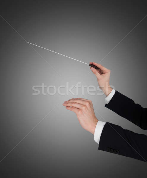 Closeup Of Music Conductor's Hands Holding Baton Stock photo © AndreyPopov