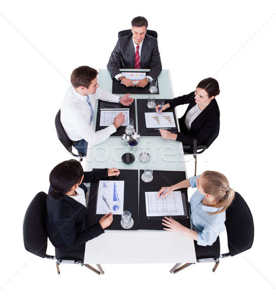 Businesspeople Discussing Over Graphs At Conference Table Stock photo © AndreyPopov