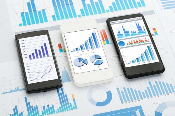 Mobiele telefoon analytics mobiele telefoons grafieken charts papier Stockfoto © AndreyPopov