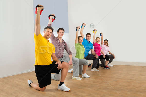 People Working Out With Kettle Bell Weights Stock photo © AndreyPopov