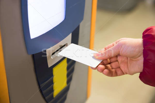Woman Inserting Parking Ticket Into Machine Stock photo © AndreyPopov