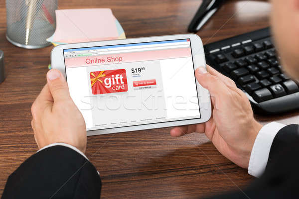 Businessperson Shopping Online With Mobile Phone Stock photo © AndreyPopov