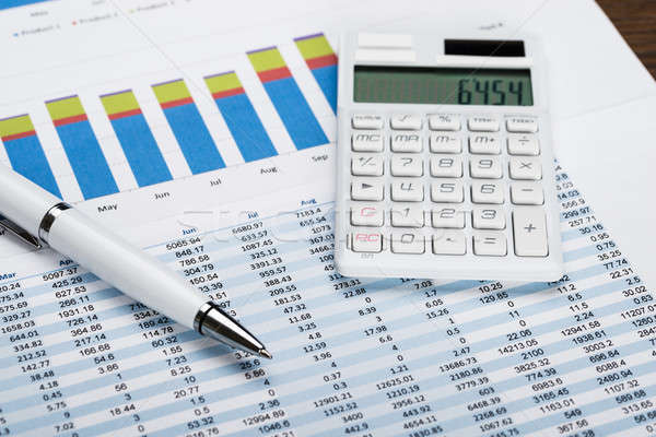 Financial Data Sheet With Calculator And Pen Stock photo © AndreyPopov