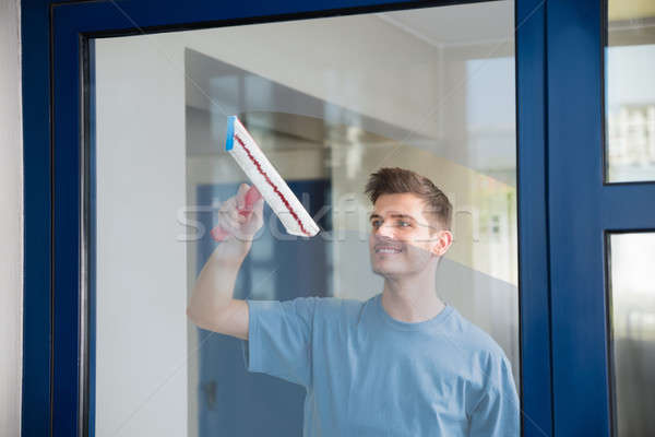 Worker Cleaning Glass With Mop Stock photo © AndreyPopov