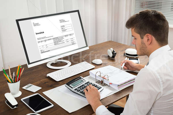 Accountant Calculating Tax At Desk Stock photo © AndreyPopov