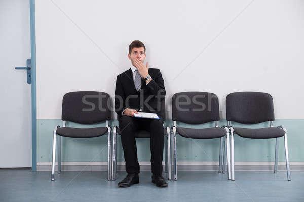 üzletember ásít ül szék fiatal tart Stock fotó © AndreyPopov