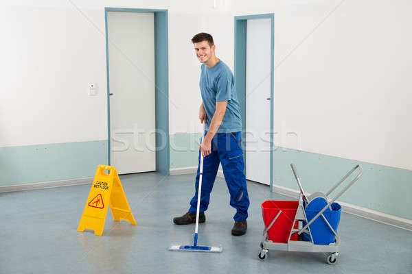 Male Worker With Cleaning Equipments Mopping Floor Stock photo © AndreyPopov
