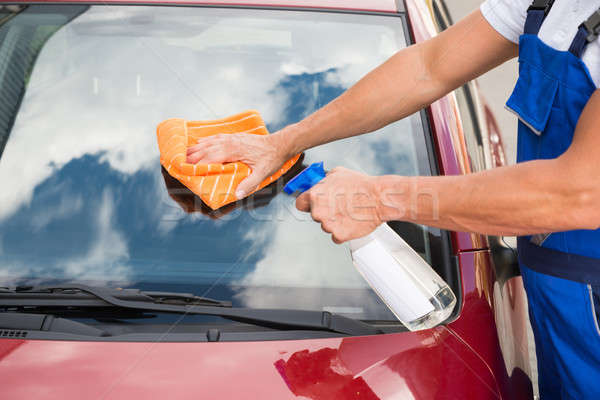 Worker Cleaning Car Windshield Stock photo © AndreyPopov