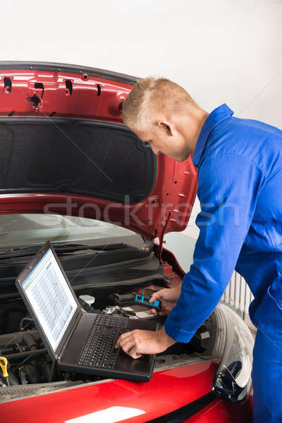 Mechanic Using Laptop While Repairing Car Stock photo © AndreyPopov