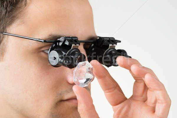 Jeweler Examining Diamond With Magnifying Glass Stock photo © AndreyPopov