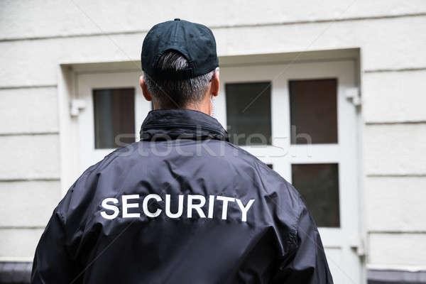 охранник Постоянный за пределами здании вид сзади зрелый Сток-фото © AndreyPopov