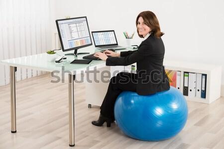 Işkadını oturma pilates top genç Stok fotoğraf © AndreyPopov