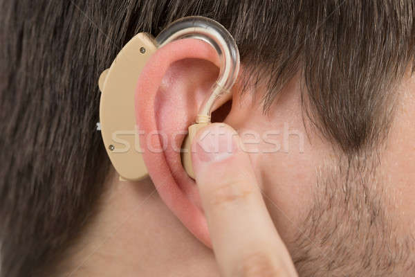 男 着用 補聴器 耳 クローズアップ 家 ストックフォト © AndreyPopov