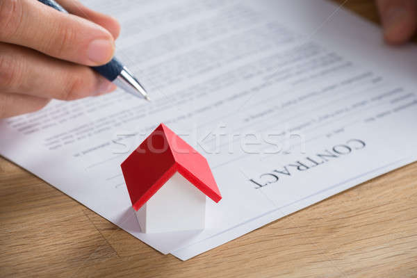 Businessman Holding Pen On Contract Paper Stock photo © AndreyPopov