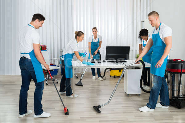 Group Of Janitors Cleaning The Office Stock photo © AndreyPopov
