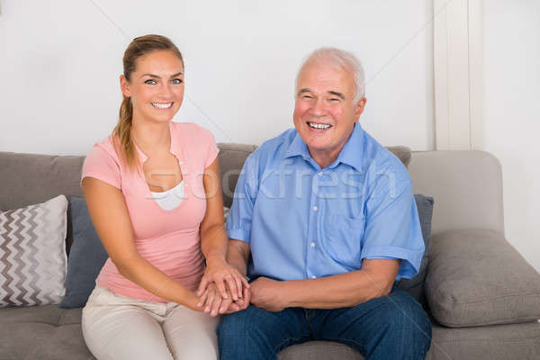 Woman Sitting On Sofa Holding Her Father's Hand Stock photo © AndreyPopov