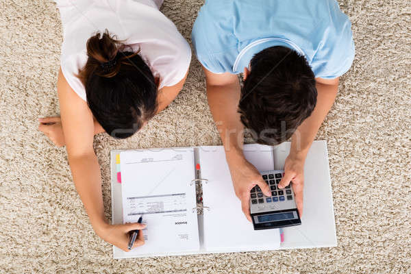 High Angle View Of Couple Calculating Budget Stock photo © AndreyPopov
